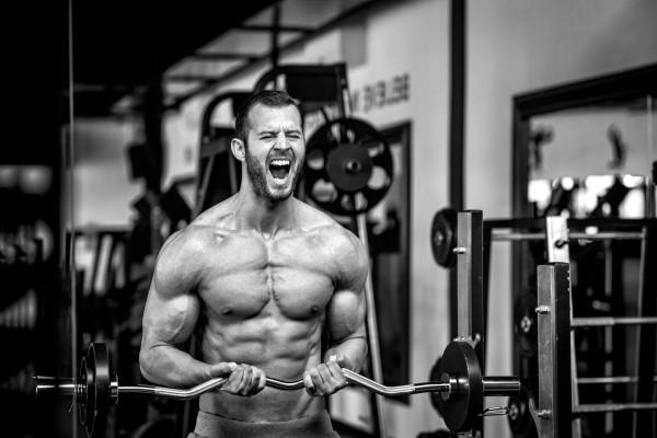 Man lifting weights at the gym.