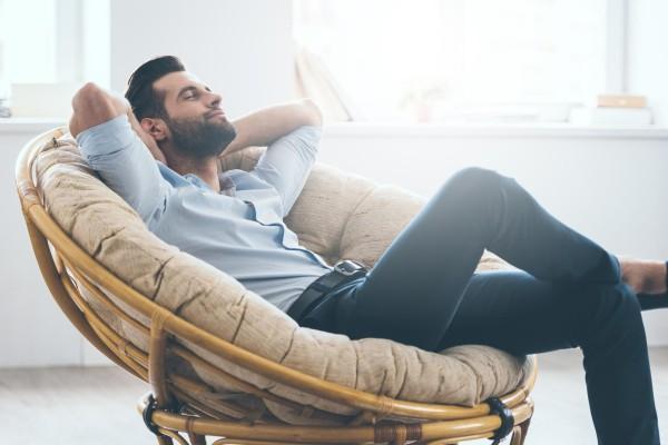 Man sitting in a chair.