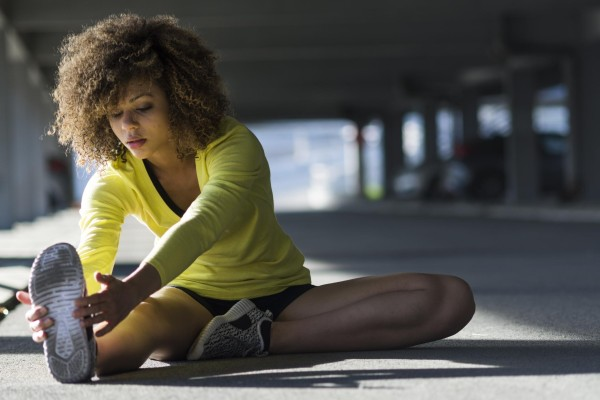 Woman stretching before a workout.