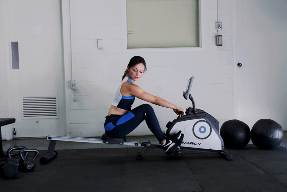 Female Model Rowing in Home Gym